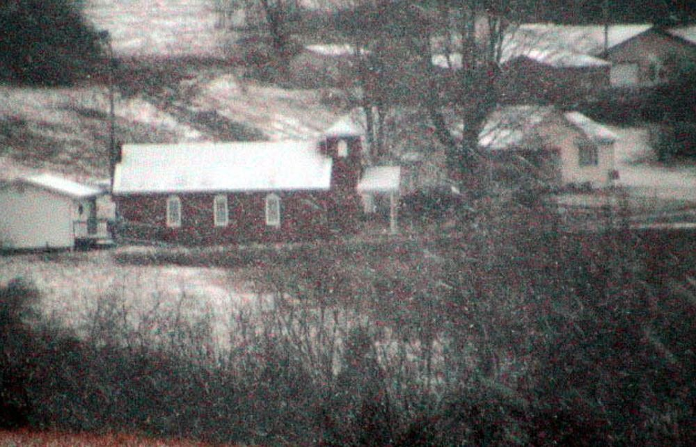 Country Church in a Snowstorm